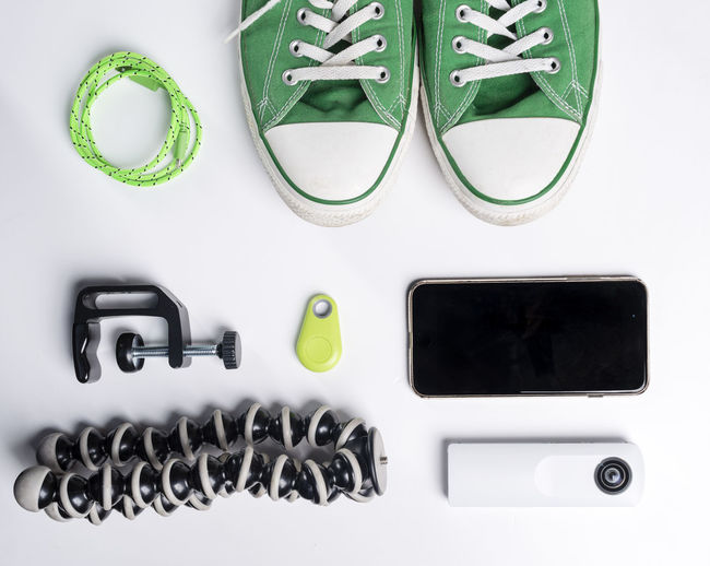 Close-up of personal accessories over white background