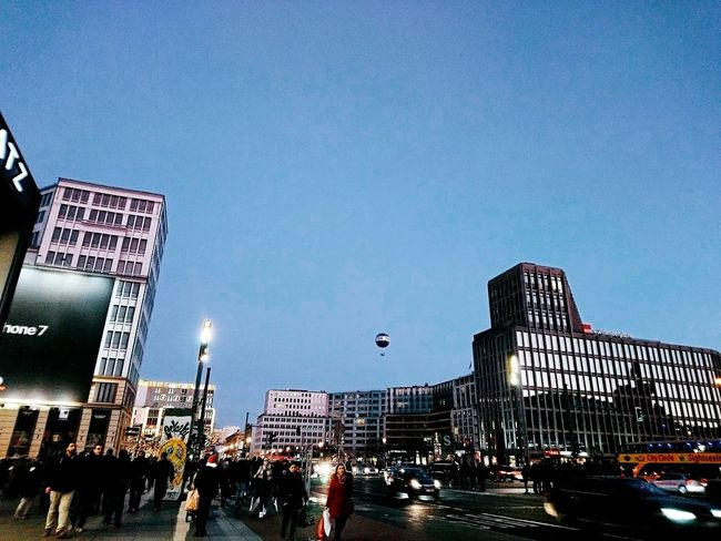 Potsdamer Platz Berlin, Germany  Lots Of People Urbanphotography Street Evening After Movies Rainy Day Blue Sky Balloon Advertising Smartphonephotography Streetlamps Cars Going To Be Dark