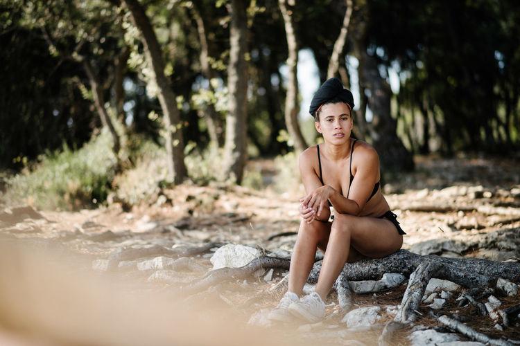 Portrait Of Woman Sitting On Field