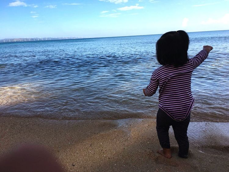 Aim high Rear View Water Real People Sea One Person Standing Sky Nature Beauty In Nature Beach Outdoors
