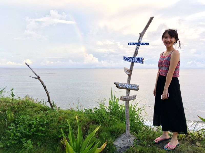 What did you spot? ✨ Standing Real People Text Casual Clothing Sea Sky Outdoors Day One Person Scenics Cloud - Sky Nature Leisure Activity Full Length Water Beauty In Nature Horizon Over Water Young Adult Young Women Rainbow