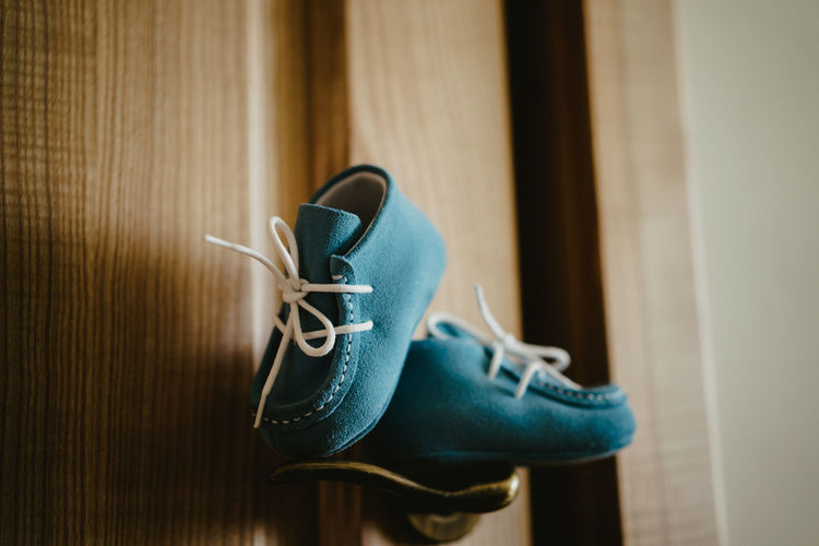 Close-up of shoes on wooden floor