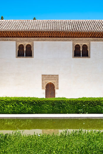 Alhambra (Granada) Alhambra De Granada  The Week on EyeEm Alhambra Architecture Brick Building Exterior Built Structure Day Fort Grass Green Color Hedge History House Mansion Nature No People Outdoors Plant Religion Sky The Past Wall Wall - Building Feature
