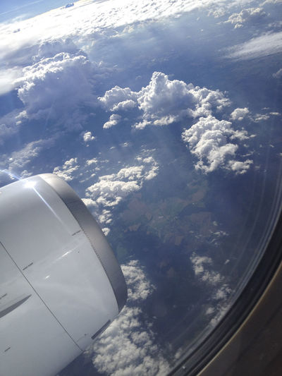 Aerial view of aircraft wing against sky
