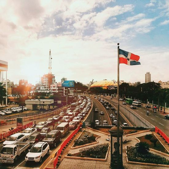 Flag City Traffic Sky Patriotism Architecture Cityscape Latin America Meizumx6 Dominican Republic City Barrio Avenida City Life Citylife Street Neighborhood Map The Great Outdoors - 2017 EyeEm Awards My Best Travel Photo