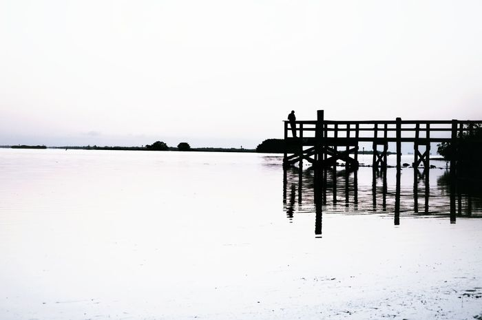 Minimalism Look Out Pier Water Black And White Trees Sky Water Reflections Man Horizon Long Distance  Silhouette One Person Outdoors Nature Selective Focus The Great Outdoors - 2016 EyeEm Awards Florida Swfl Swflorida United States Bokeelia Copy Space Hidden Gems