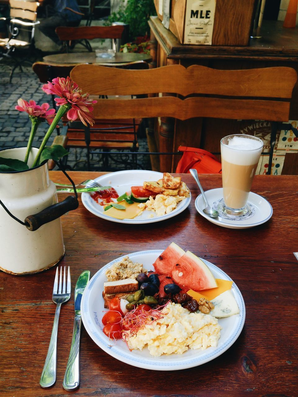 High Angle View Of Fresh Breakfast And Coffee Served On Table At Sidewalk Cafe