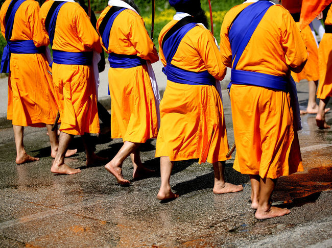 Sikh soldiers with swords walk barefoot Sikhi barefoot City Clothing Group Of People Lifestyles Outdoors Real People Rear View Religion Religions Sikh Sikh People Sikh Religion Sikhism Sikhlife Sikhs Street Togetherness Traditional Clothing