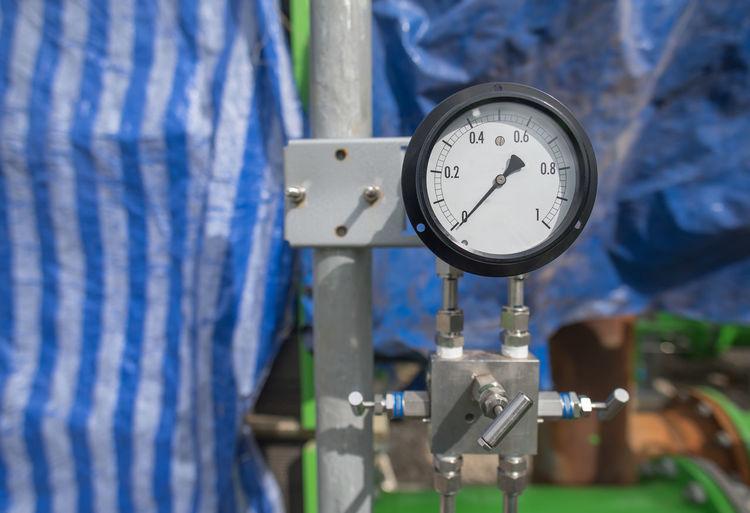 Close-up of pressure gauge at factory