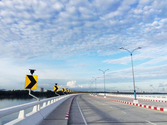 Road Sign On Bridge Against Sky