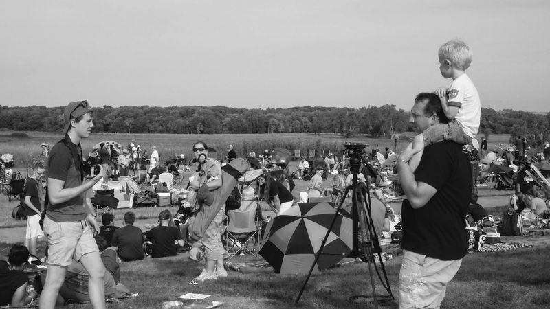 """Visual Journal August 21, 2017 """"Great American eclipse"""" Homestead National Monument Beatrice, Nebraska Beatrice Nebraska Camera Work Documentary Photography Eclipse Day EyeEm Best Shots Getty Images Homestead National Monument Nebraska Photo Essay Piggyback Solar Eclipse 2017 Storytelling Visual Journal Adult B&w Street Photography Bride Bridegroom Day Enjoyment Find Your Park Friendship Fujifilm_xseries Full Length Great American Eclipse Large Group Of People Leisure Activity Lifestyles Men Nature Outdoors People Photo Diary Real People Sky Small Town Stories Solar Eclipse Standing Streetphoto_bw Togetherness Women Young Adult Young Women"""