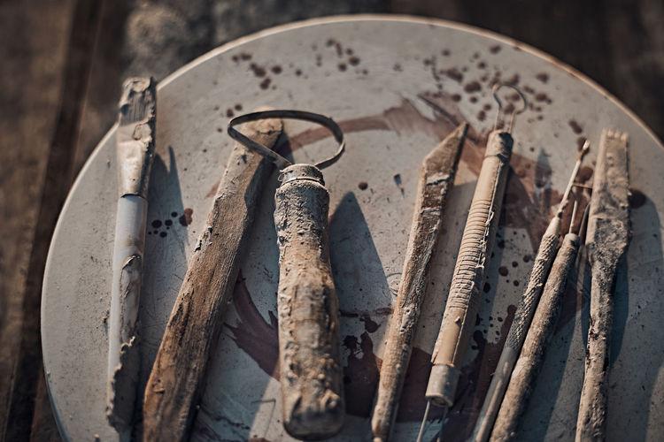 High angle view of metallic tools on table