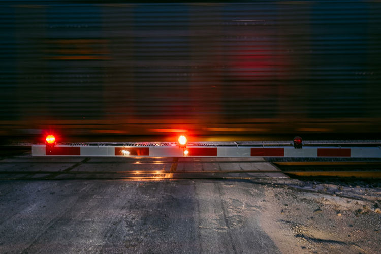 Train Transportation Mode Of Transportation Illuminated Motion Architecture Land Vehicle No People City Blurred Motion Night Street Road Nature Rail Transportation Outdoors Speed Built Structure Truck Winter