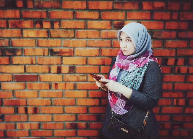 Lady looking at someone/something. Brick Brick Wall Brick Wall Background Woman Portrait Muslimah Muslim Woman Muslim Girl Memories Staring Into Space Looking Away Looking To The Other Side Looking To The Other Side Wireless Technology Technology Warm Clothing Childhood Standing Girls Internet Holding Communication Pixelated Text Messaging Social Networking Online Messaging Cellphone