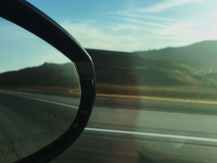 Road trip Mode Of Transportation Glass - Material Transportation Vehicle Interior Sky Motor Vehicle Summer Road Tripping Cloud - Sky Land Vehicle Motion on the move Window Reflection Side-view Mirror Car No People Travel Road Transparent Nature Close-up Humanity Meets Technology