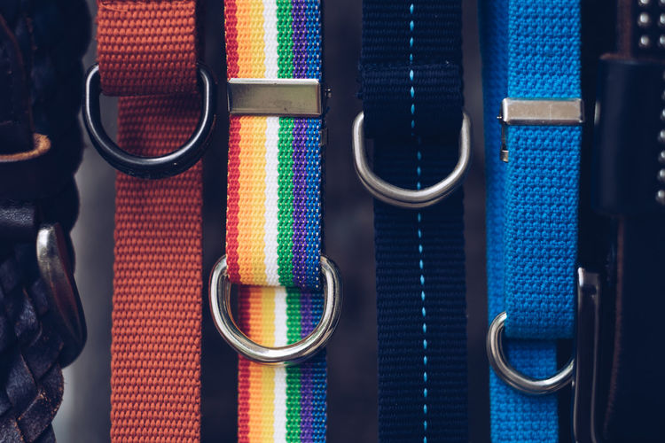 Close-up of colorful belts for sale