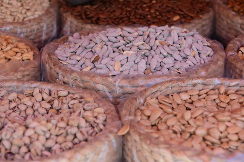 Full Frame Shot Of Various Nuts In Wicker Container At Market