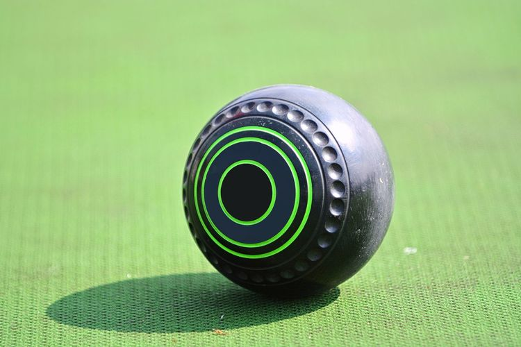 Lawn bowl on the green field Ball Lawn Bowls Bowl Bowling Lawn Green Field Outdoor Sport Healthy Competition Close-up Backgrounds Eyeemphotography Business EyeEm Selects EyeEm Best Shots EyeEmBestPics Athlete Close-up Green Color Detail Grassland Circle