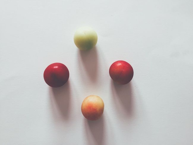Fruits Minimalism Simplicity Green Color Red Yellow Food Food And Drink Fruit Healthy Eating Indoors  Freshness Still Life Red Close-up No People Table Directly Above Studio Shot Group Of Objects High Angle View Shadow White Color Wellbeing Medium Group Of Objects