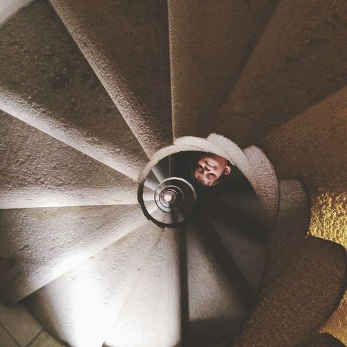 Low Angle View Of Child On Spiral Staircase