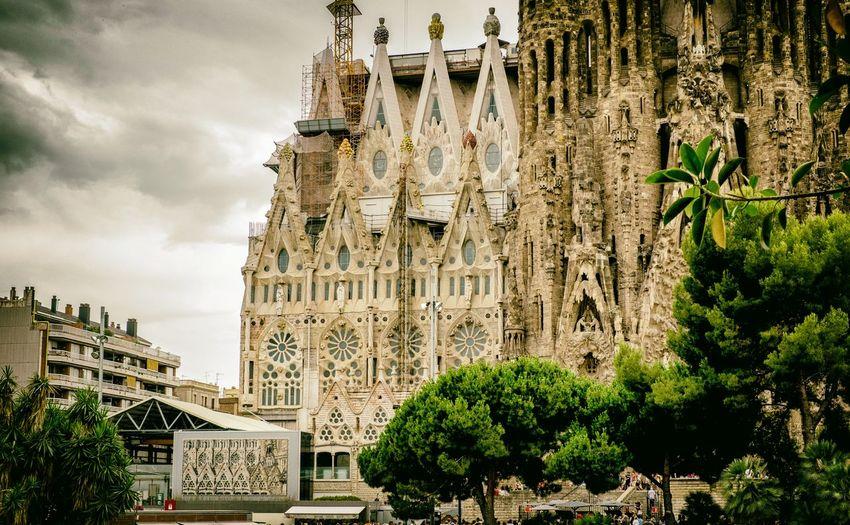 Low angle view of sagrada familia in city
