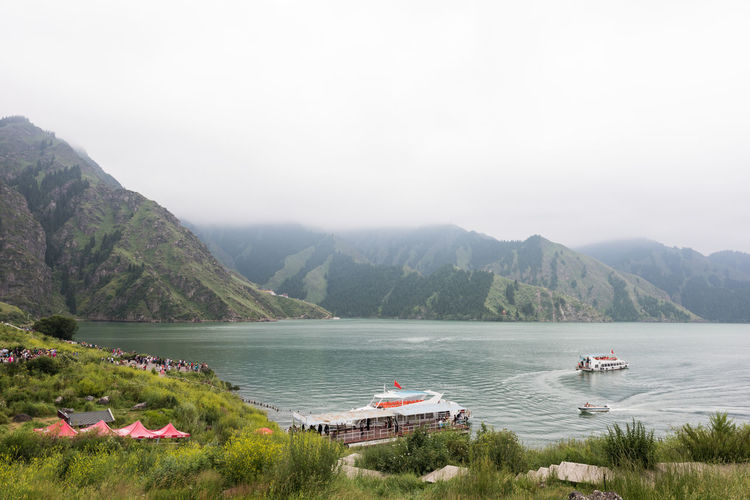 Scenic View Of Boats In Lake