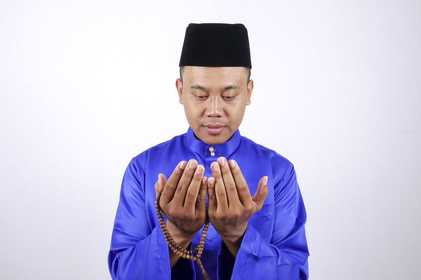 MAN PRAYING Baju Melayu Eid Mubarak Hari Raya Aidilfitri Adult Angpow Body Part Front View Hand Human Arm Human Body Part Human Hand Human Limb Indoors  Males  Men Menswear Mid Adult Money Packet One Person Portrait Standing Studio Shot Waist Up White Background Young Adult