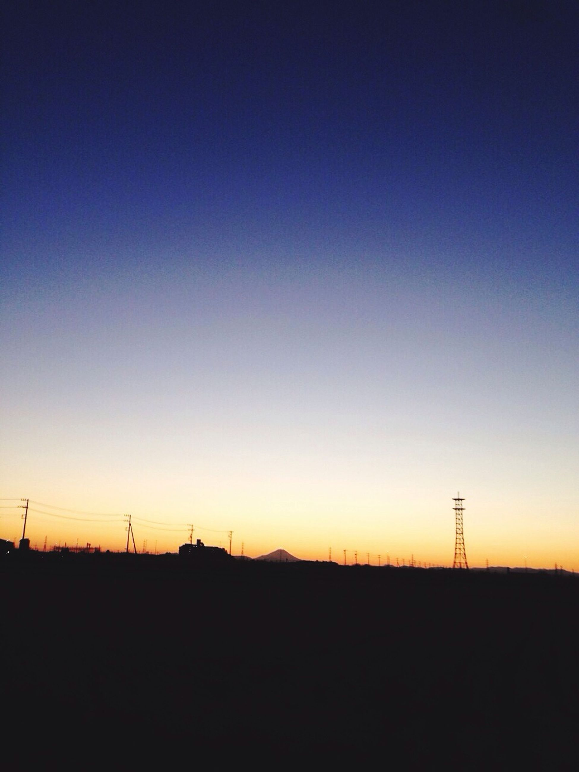 silhouette, copy space, sunset, clear sky, landscape, fuel and power generation, tranquil scene, tranquility, electricity pylon, technology, field, wind power, scenics, wind turbine, nature, horizon over land, beauty in nature, electricity, alternative energy, environmental conservation