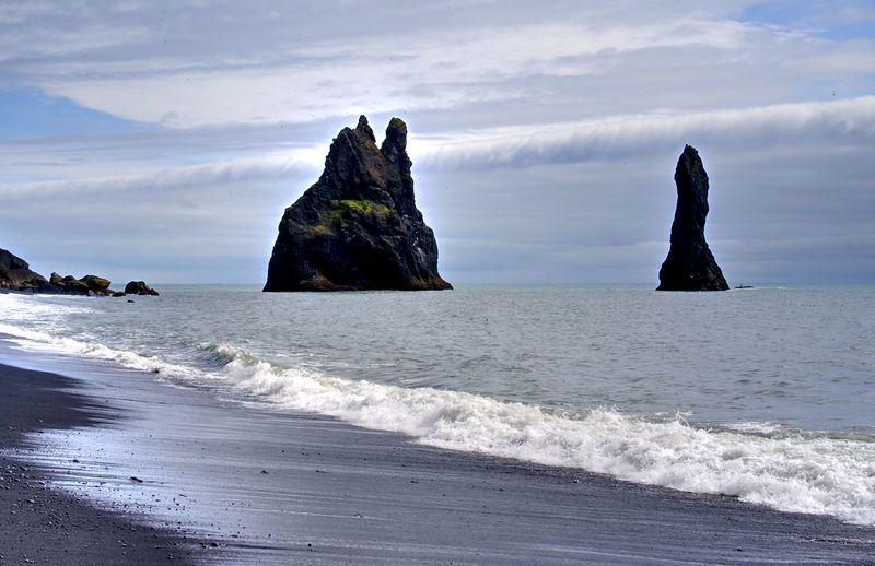 Black beach and sea rocks in Iceland Iceland Beach Beauty In Nature Black Horizon Horizon Over Water Island Land Nature Outdoors Rock Rocks Scenics - Nature Sea Sky Volcanic Landscape Water