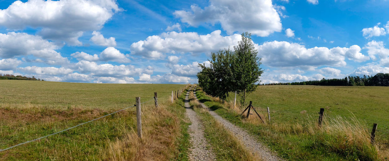 Just a beautiful day in a rural part of Germany... Hiking Panorama Remote Location Agriculture Cloud - Sky Field Hiking Trail Landscape Nature No People Outdoors Panoramic Landscape Rural Landscape Rural Scene Sky Tranquil Scene