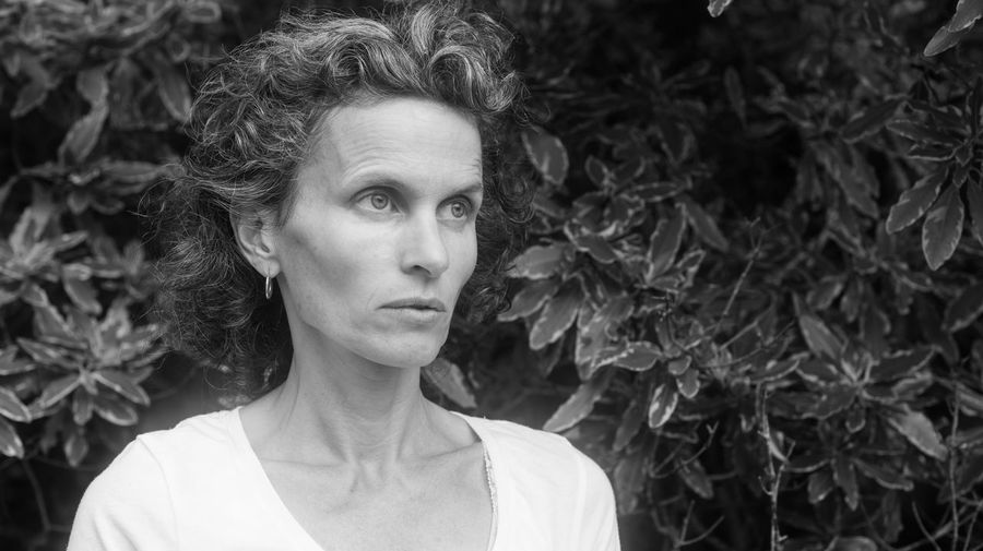 Portrait of mature woman against leaves (black and white) Nature Adult Adults Only Beautiful Woman Black And White Blond Hair Close-up Day Focus On Foreground Front View Headshot Mature Adult One Person One Woman Only Only Women Outdoors People Portrait Real People Serious Women