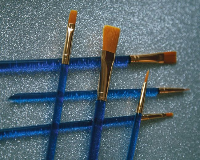 High angle view of clothespins on floor against blue background