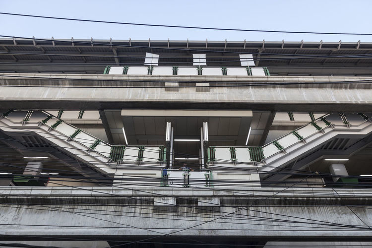 Low angle view of bts skytrain building against sky
