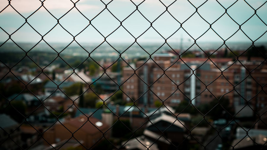 Backgrounds Barrier Boundary Chainlink Fence Close-up Crisscross Day Fence Focus On Foreground Forbidden Full Frame Metal Nature No People Outdoors Pattern Playing Field Protection Safety Security Sport