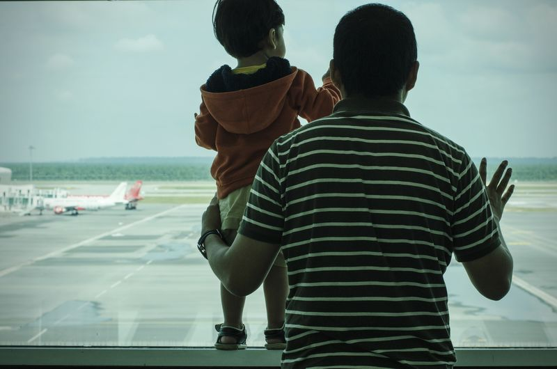 Father and son Traveling Journey Father Son Airport Window Glass - Material Glass Window Family Two People Rear View Togetherness Striped Love Casual Clothing Bonding People Men EyeEmNewHere