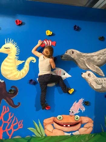Climbing Representation Full Length Art And Craft Creativity Real People Day Human Arm Human Representation Leisure Activity People Childhood Lifestyles Arts Culture And Entertainment Decoration Men Outdoors Arms Raised