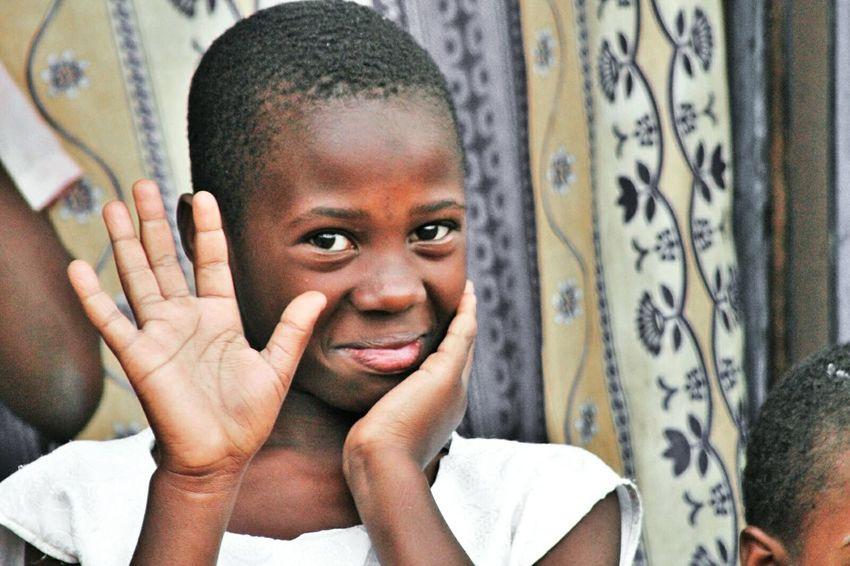 girl orphan but smiling and beeing gratful uganda