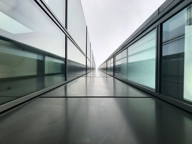 Arcade Architecture Building Built Structure Corridor Day Direction Empty Glass - Material Indoors  Modern Moving Walkway  No People Reflection The Way Forward Transparent Transportation Wall - Building Feature Window