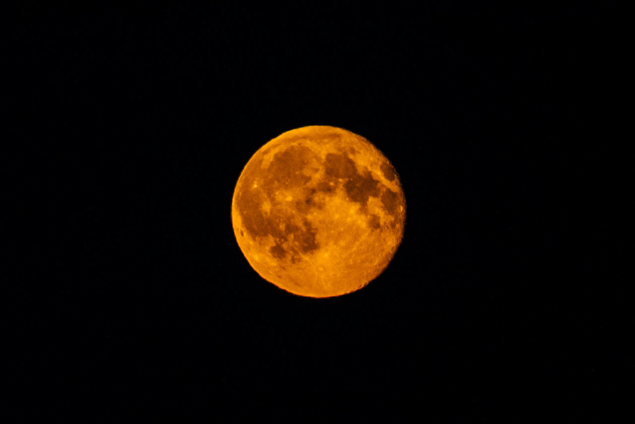 moon, night, full moon, astronomy, moon surface, circle, beauty in nature, planetary moon, nature, no people, yellow, scenics, low angle view, tranquility, outdoors, sky, clear sky, space