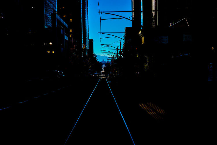 Downtown Salt Lake City: standing on the Trax train's rails, gaining a parallel perspective to my current perils. Adapted To The City Art Cityscape Creative Photography Dark Foreground Fine Art Photography Light Rail Light Rail Tracks Light Rail Transit No People Outdoors Perspective Taken By M. Leith Tracks Transportation Urban Landscape Wall Art Art Is Everywhere The Street Photographer - 2017 EyeEm Awards