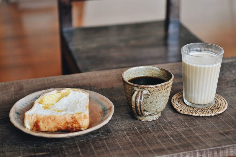 Hotcoffee Cold Drink Craft Food And Drink Food Table Drink Freshness Still Life Refreshment Indoors  No People Glass Ready-to-eat Drinking Glass Household Equipment Cup Bread Coffee Wellbeing Healthy Eating Plate Focus On Foreground