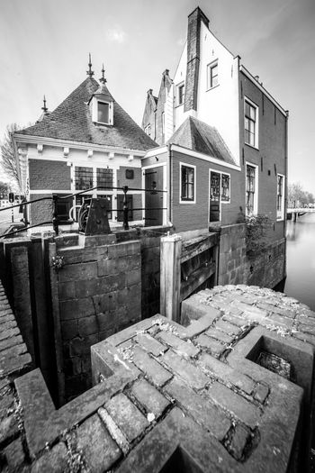 Gouda in black and white (2) Architecture Built Structure Building Exterior Building Sky Cloud - Sky No People Day House Nature City Residential District Old Outdoors Wall - Building Feature Wood - Material Town Footpath Transportation Wall
