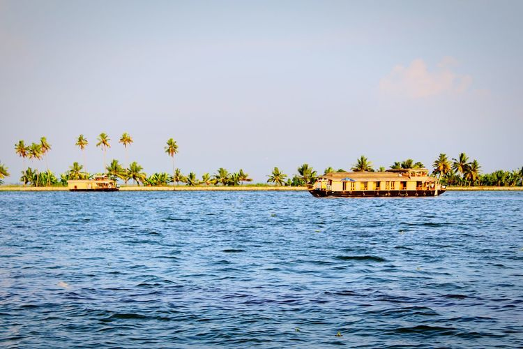 Water Nature Vacations Travel Tree Palm Tree Tropical Climate Stilt House Architecture Lake Outdoors Built Structure Tranquility Cloud - Sky Building Exterior Day Travel Destinations Landscape No People Nautical Vessel Kerala Backwaters Boathouse Architecture Coconut Trees Sea And Sky
