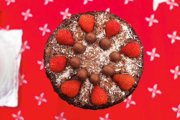 Chocolate Circle Cake Celebration Chocolate Cake Close-up Colored Background Directly Above Food Food And Drink Indulgence No People Red Red Background Strawberry Sweet Food Symmetry Temptation