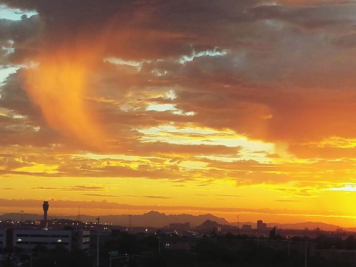 A very interesting morning at Sky Harbor Airport with the virga highlighted with the rising sun. Sunrise Dramatic Sky Orange Color Cloud - Sky Yellow Sun Sky City Silhouette No People Landscape Business Finance And Industry Outdoors Multi Colored Urban Skyline Beauty Travel Destinations Vacations Awe Cityscape Virga