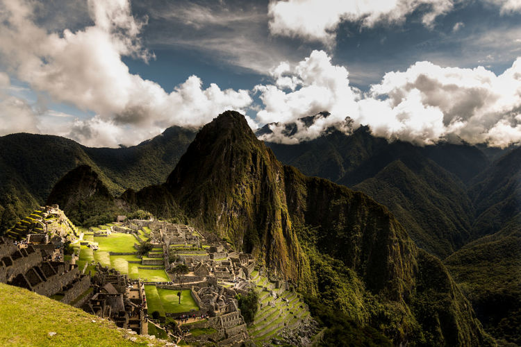 View Of Machu Picchu Against Cloudy Sky