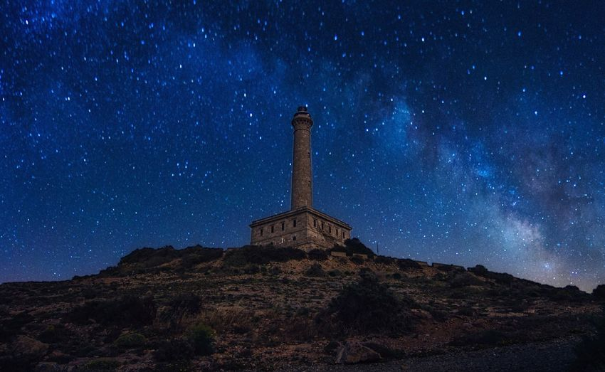 Nightphotography EyeEm Best Shots Landscape EyeEmNewHere Eye4photography  Lighthouse Night Star - Space Astronomy Sky Space Scenics - Nature Architecture Galaxy Nature Milky Way Built Structure Blue Landscape Space And Astronomy Outdoors