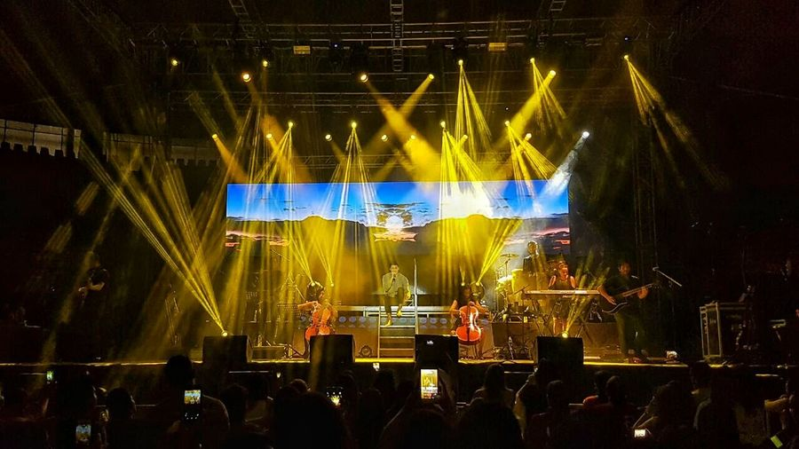 Illuminated Arts Culture And Entertainment Night Stage - Performance Space Music Event Lighting Equipment Enjoyment Musical Instrument Musician Leisure Activity Performance Playing Nightlife Stage Light Light Beam Entertainment Occupation Rock Music Electric Light Performer