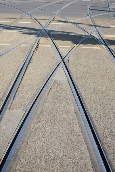 Tram tracks with complicated switch point junction Asphalt Berlin Cable Car Chaos Choice City Close-up Complicated Crossing Day Junction Multiple No People Outdoors Paths Road Street Street Cars Switch Switch Point Tracks Train Tram