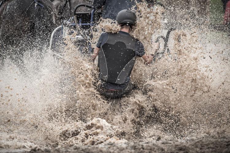 Blurred motion of man splashing water
